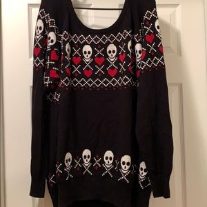 Black sweater with hearts and skulls